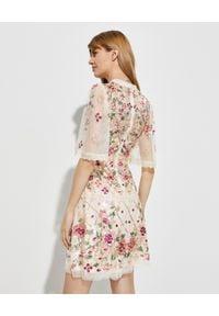 NEEDLE & THREAD - Beżowa sukienka z cekinami Trellis Rose. Okazja: na imprezę. Kolor: beżowy. Materiał: koronka. Wzór: kwiaty, aplikacja. Długość: mini