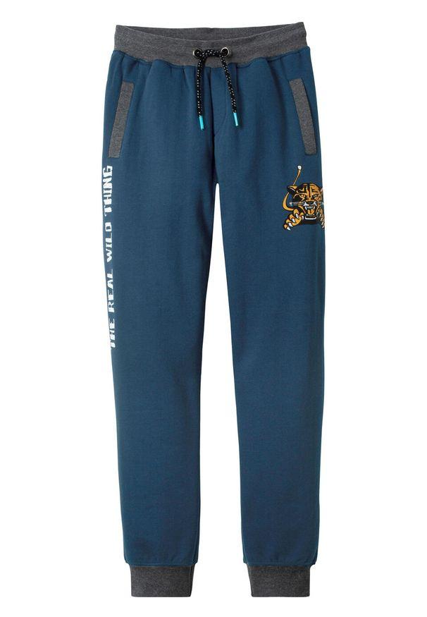 Niebieskie spodnie bonprix z aplikacjami, sportowe