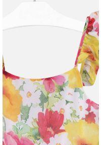 Różowa sukienka Mayoral rozkloszowana, mini, w kwiaty, na ramiączkach