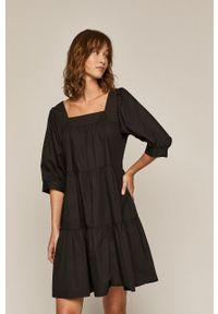 medicine - Medicine - Sukienka Divine Love. Kolor: czarny. Materiał: bawełna, tkanina. Długość rękawa: krótki rękaw. Wzór: gładki. Typ sukienki: rozkloszowane