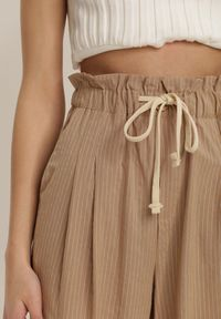 Beżowe spodnie z wysokim stanem Renee