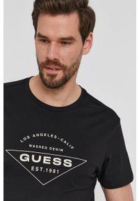 Guess - T-shirt. Okazja: na co dzień. Kolor: czarny. Wzór: nadruk. Styl: casual