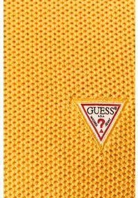 Żółty sweter Guess Jeans z aplikacjami