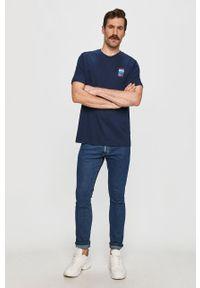 Niebieski t-shirt adidas Originals na co dzień, z nadrukiem, casualowy