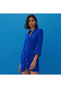 Niebieska sukienka Reserved koszulowa