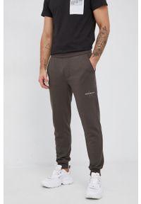 Calvin Klein Jeans - Spodnie. Kolor: zielony. Materiał: bawełna, poliester
