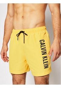 Calvin Klein Swimwear Szorty kąpielowe Medium Drawstring KM0KM00570 Żółty Regular Fit. Kolor: żółty