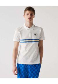 Lacoste - LACOSTE - Biała koszulka polo z paskami Regular Fit. Typ kołnierza: polo. Kolor: biały. Materiał: bawełna. Styl: klasyczny