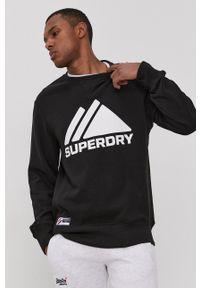 Superdry - Bluza. Kolor: czarny. Materiał: dzianina. Wzór: nadruk