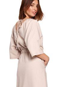 BE - Swobodna sukienka midi z szeroką gumą w pasie beżowa. Okazja: na co dzień. Kolor: beżowy. Materiał: guma. Sezon: lato, wiosna. Typ sukienki: proste. Styl: boho, casual. Długość: midi