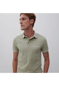 Reserved - Koszulka polo z bawełnianej dzianiny - Zielony. Typ kołnierza: polo. Kolor: zielony. Materiał: bawełna, dzianina