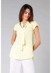 Żółta bluzka Nommo z asymetrycznym kołnierzem