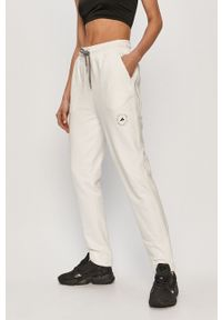 Adidas by Stella McCartney - adidas by Stella McCartney - Spodnie. Kolor: biały. Materiał: dzianina. Wzór: gładki