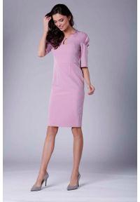 Różowa sukienka wizytowa Nommo elegancka
