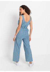 """Kombinezon dżinsowy z szerokimi nogawkami bonprix jasnoniebieski """"bleached"""". Kolor: niebieski. Sezon: lato"""