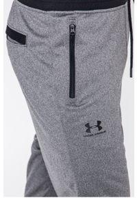Szare spodnie dresowe Under Armour melanż