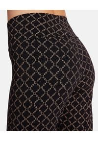 Wolford - WOLFORD - Czarne legginsy z nadrukiem. Kolor: czarny. Materiał: jersey. Wzór: nadruk