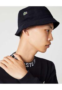 Lacoste - LACOSTE - Czarny kapelusz z wyhaftowanym logo. Kolor: czarny. Materiał: bawełna