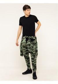Zielone spodnie dresowe Calvin Klein Performance