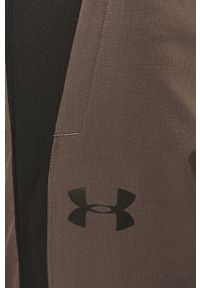Under Armour - Spodnie. Kolor: szary. Materiał: tkanina
