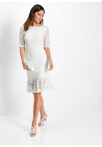 Sukienka koronkowa z falbaną w dolnej części bonprix biel wełny. Kolor: biały. Materiał: wełna, koronka. Wzór: koronka