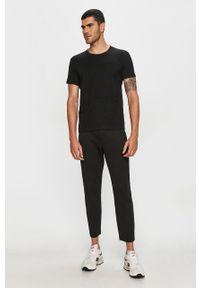 Czarny t-shirt Calvin Klein Jeans z aplikacjami, casualowy, na co dzień, z okrągłym kołnierzem