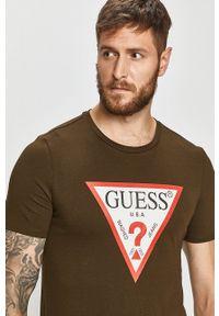 Guess Jeans - T-shirt. Okazja: na co dzień. Kolor: zielony. Materiał: jeans. Wzór: nadruk. Styl: casual