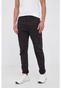 C.P. Company - Spodnie. Okazja: na co dzień. Kolor: czarny. Materiał: tkanina. Wzór: gładki. Styl: casual