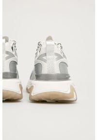 Białe sneakersy Karl Lagerfeld na obcasie, z cholewką