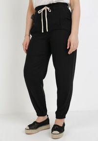 Czarne spodnie z wysokim stanem Born2be