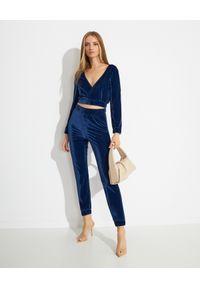MISSION SWIM - Niebieska bluzka Linda. Kolor: niebieski. Materiał: materiał. Długość rękawa: długi rękaw. Długość: długie