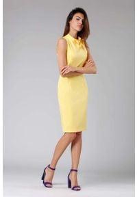 Nommo - Żółta Ołówkowa Sukienka z Kokardą. Typ kołnierza: kokarda. Kolor: żółty. Materiał: wiskoza, poliester. Typ sukienki: ołówkowe