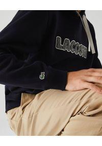 Lacoste - LACOSTE - Granatowa bluza z kapturem. Okazja: na co dzień. Typ kołnierza: kaptur. Kolor: niebieski. Materiał: jeans. Wzór: nadruk. Sezon: jesień. Styl: sportowy, casual