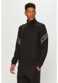Calvin Klein Performance - Bluza. Okazja: na co dzień. Kolor: czarny. Długość: krótkie. Wzór: aplikacja. Styl: casual
