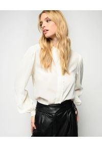 Pinko - PINKO - Biała koszula z falbanką Labile. Typ kołnierza: kołnierz z falbankami. Kolor: biały. Materiał: jedwab, jeans, tkanina. Długość rękawa: długi rękaw. Długość: długie. Styl: elegancki