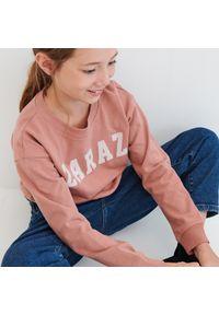 Różowa bluza Reserved z napisami