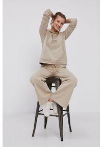 Peak Performance - Bluza bawełniana. Okazja: na co dzień. Kolor: beżowy. Materiał: bawełna. Długość rękawa: długi rękaw. Długość: długie. Styl: casual