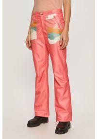 Różowe spodnie sportowe Femi Stories z aplikacjami