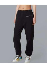 THE MARC JACOBS - Czarne spodnie dresowe z logo. Kolor: czarny. Materiał: dresówka. Wzór: aplikacja