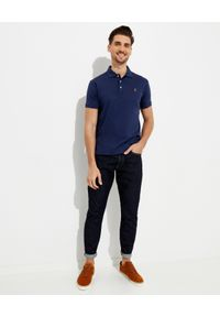 Ralph Lauren - RALPH LAUREN - Niebieska koszulka polo Slim Fit z kolorowym logo. Typ kołnierza: polo. Kolor: niebieski. Materiał: bawełna, jeans. Wzór: kolorowy