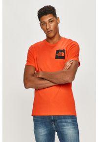 Pomarańczowy t-shirt The North Face casualowy, na co dzień, z nadrukiem