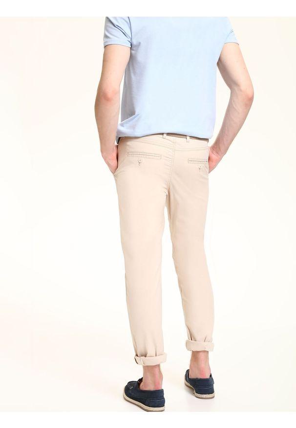 Beżowe spodnie TOP SECRET sportowe, w kolorowe wzory