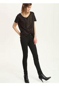 Czarne spodnie TROLL długie