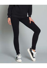 DSG - Leginsy z logo marki. Okazja: na co dzień. Kolor: czarny. Materiał: materiał. Styl: sportowy, elegancki, casual