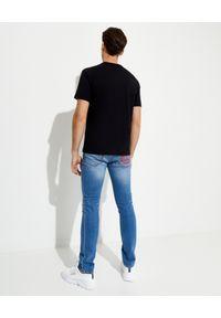 Versace Jeans Couture - VERSACE JEANS COUTURE - Niebieskie jeansy z logo. Kolor: niebieski