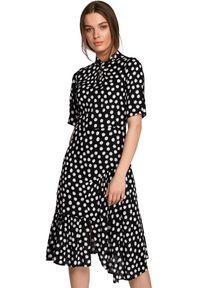 Style - Sukienka midi w duże grochy z asymetryczną falbaną czarna. Kolor: czarny. Wzór: grochy. Typ sukienki: asymetryczne. Styl: retro. Długość: midi