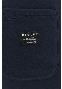 Sisley - Spodnie. Kolor: niebieski. Materiał: dzianina