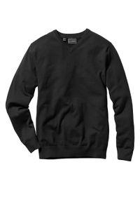 Sweter z dekoltem w serek bonprix czarny. Typ kołnierza: dekolt w serek. Kolor: czarny. Materiał: dzianina. Wzór: ze splotem, gładki. Styl: klasyczny