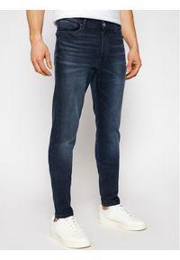Tommy Jeans Jeansy Simon Cobbs DM0DM09851 Granatowy Skinny Fit. Kolor: niebieski
