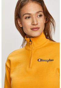Champion - Bluzka bawełniana. Okazja: na co dzień. Kolor: żółty. Materiał: bawełna. Długość rękawa: długi rękaw. Długość: krótkie. Styl: casual